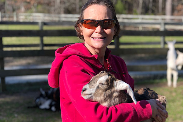 Woman holding goat