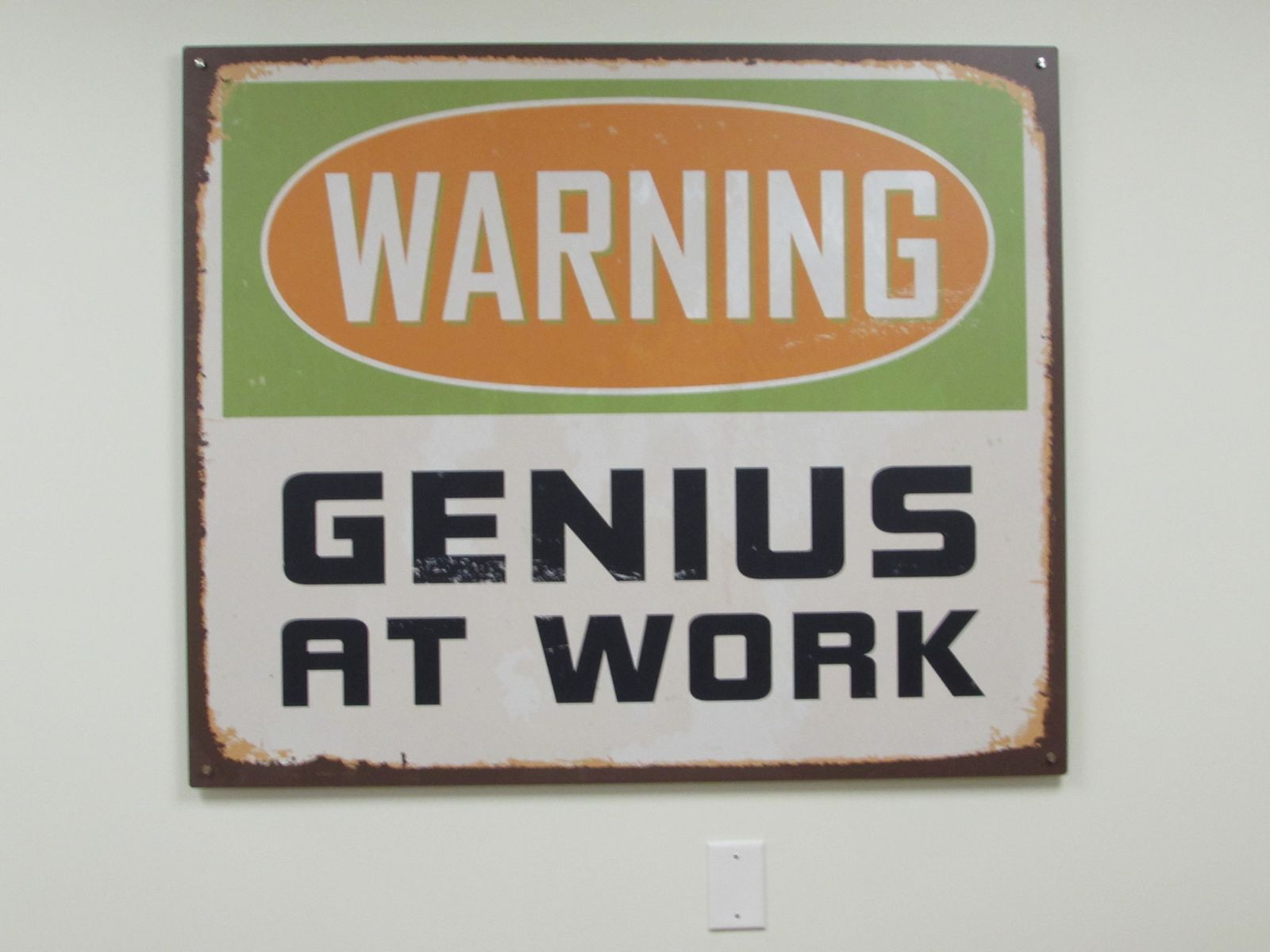 genius at work sign