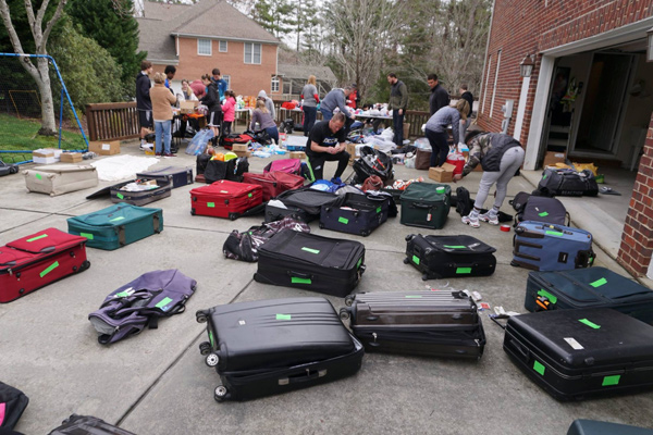 liberia mission trip team suitcases on ground