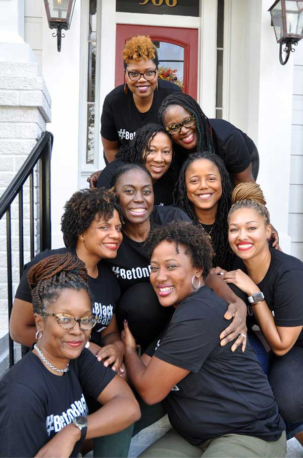 photo of Black Teacher Collaborative women wearing Bet On Black t-shirts