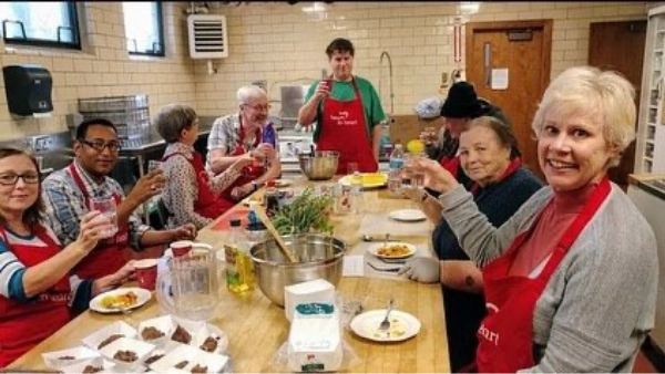 photo of volunteers cooking together