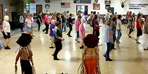 dance lessons raise money fundraising group organizing line dancing event
