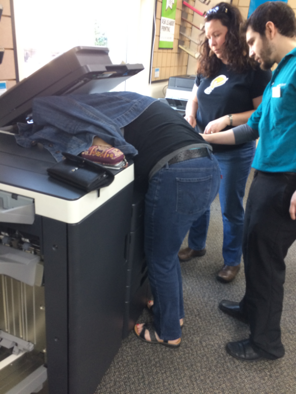 photo of teresa with her head in the copier at Kinkos