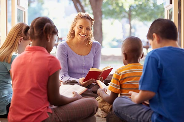 kids studying bible in group
