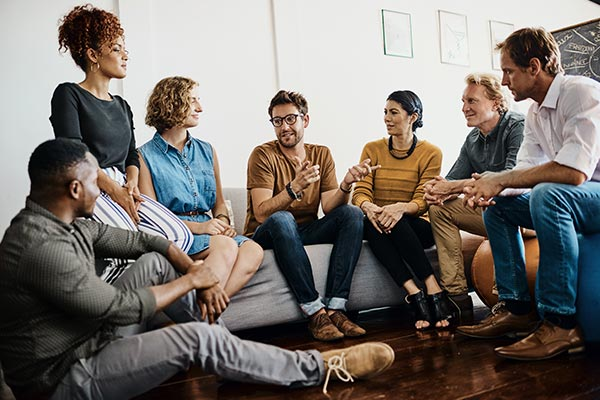 group of adults talking and listening to one another