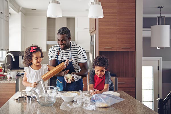 family having fun baking and cooking in kitchen