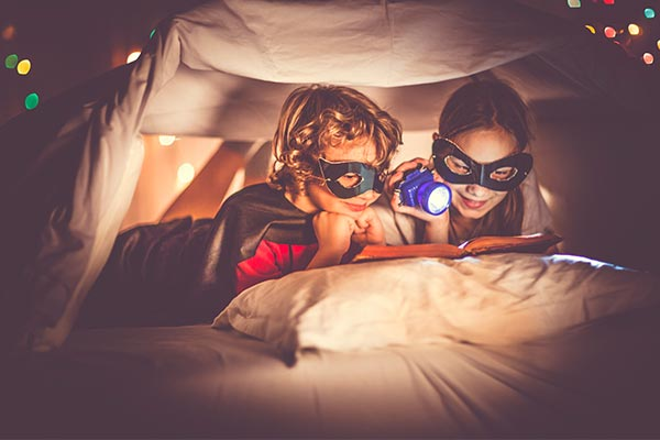 Kids Reading in a Fort with Flashlight