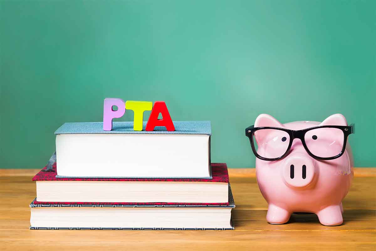 photo of piggy bank on top of books with PTA letters