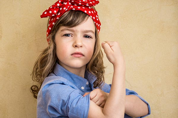 girl flexing arm to show strength