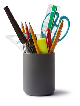 assorted office supplies in holder